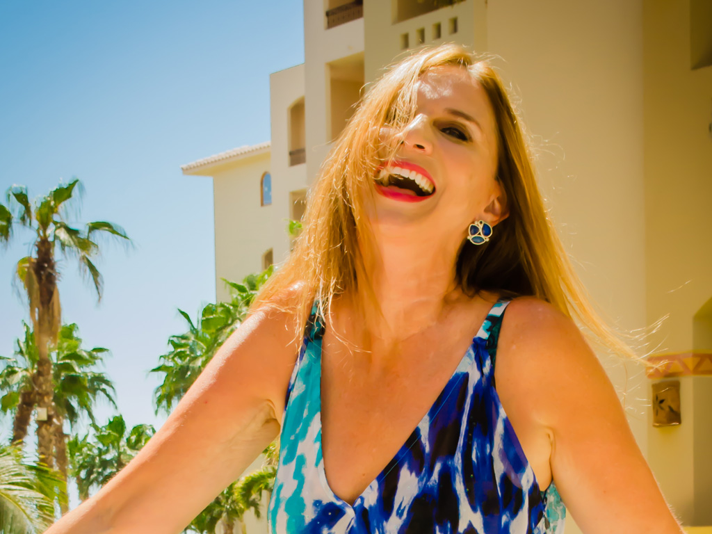 Julie laughing in fron tof building